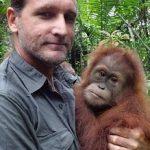 Leif Cocks holding an orangutan